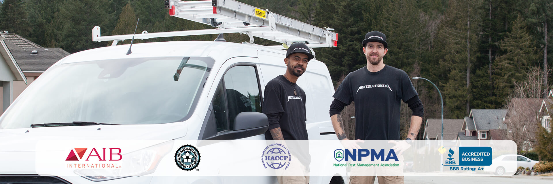 Pest control specialists in front of their service truck in a suburb community are supported by our affiliated companies