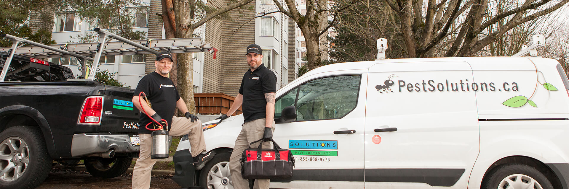 Solutions Pest Control service tech gearing up from their trucks