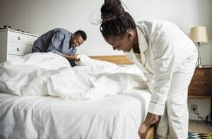 husband and wife making bed - bug free bed